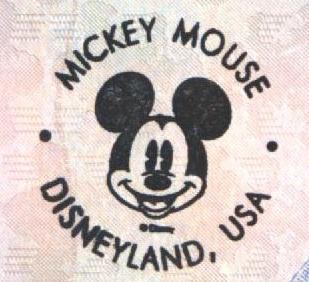 Sello Turístico de Disneyland - California, EEUU Sello Turístico en Ushuaia, Argentina (Cortesía: Gato Cósmico)