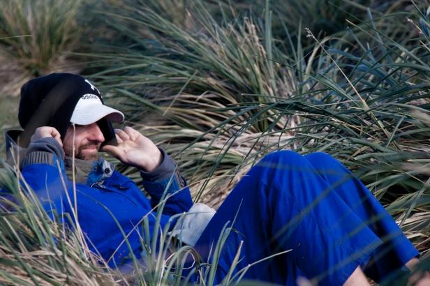 Sitting in the tussac grass_Stuart Bennett